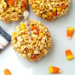 A close up of candy corn popcorn balls