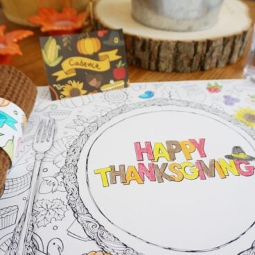 A coloring printable that says Happy Thanksgiving on the table