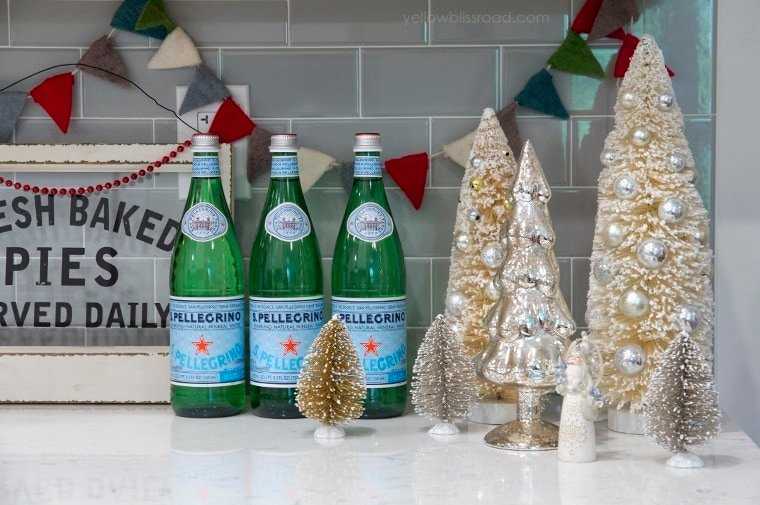 Christmas kitchen bottle brush trees and green bottles