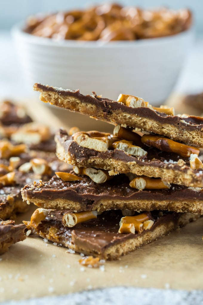 a close up of a stack of graham cracker toffee