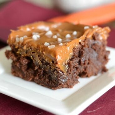 A close up of a brownie on a plate