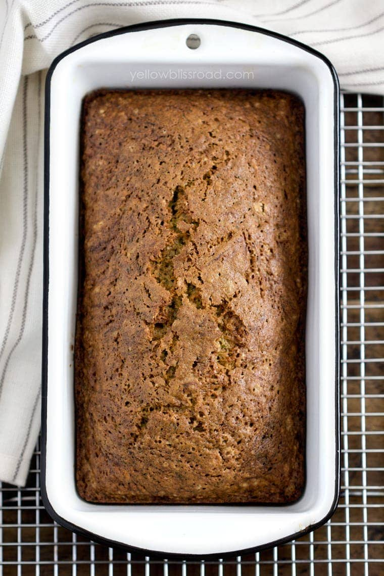 Zucchini Bread loaf in a pan on a cooling rack