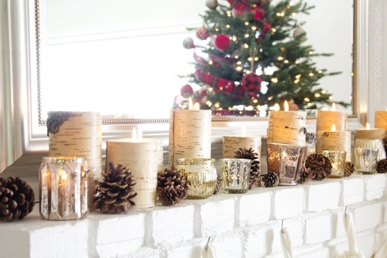 Gorgeous decorated Christmas mantel with pinecones, birch candles and mercury glass