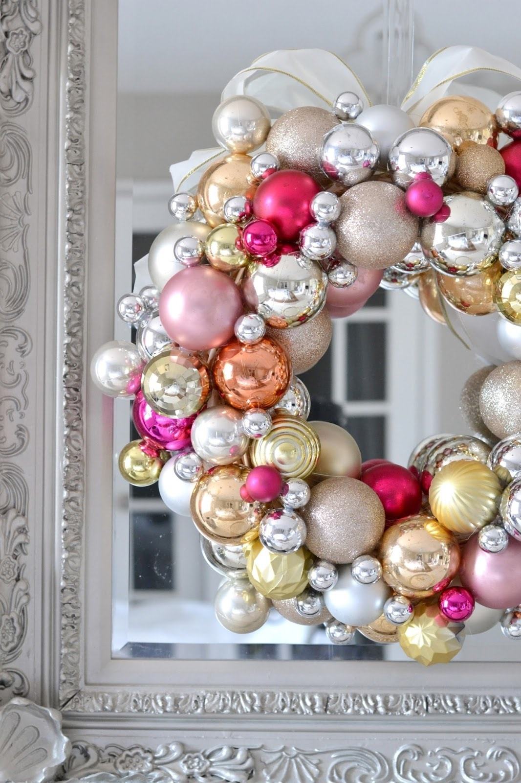 A close up of a wreath made of ornaments