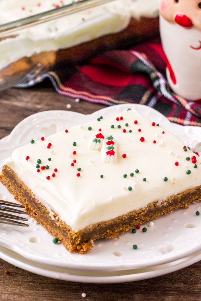 Spiced Gingerbread Cookie Bar on a white place with a Santa mug in the background.
