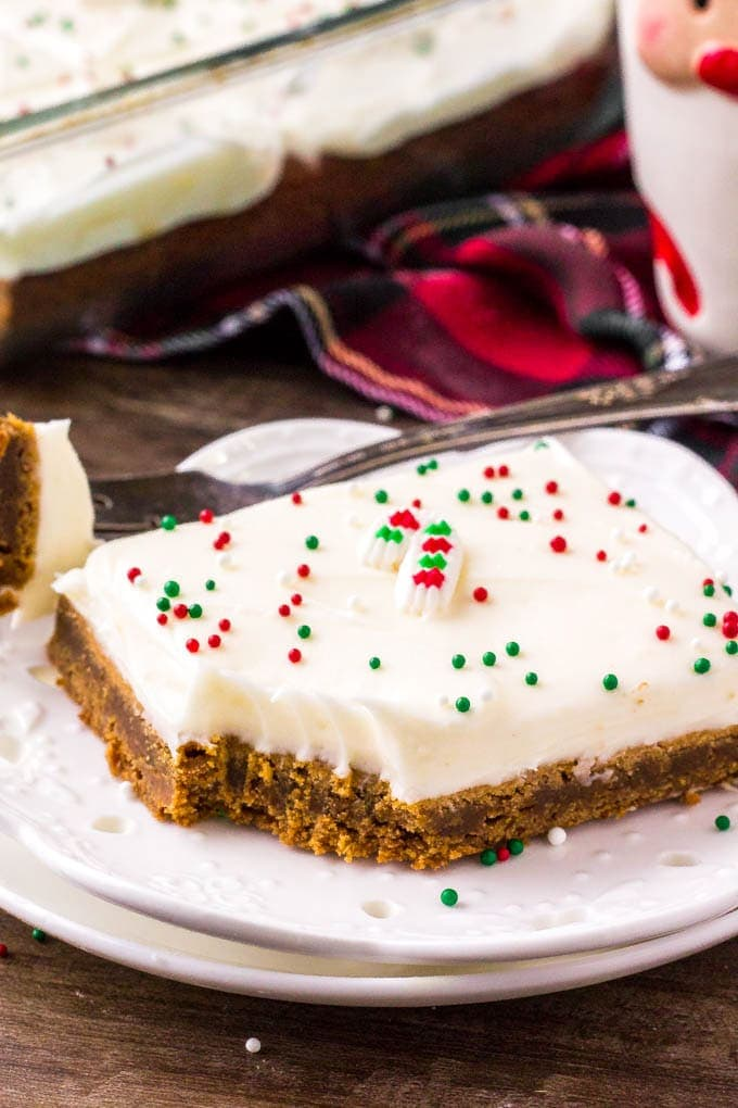 Spiced Gingerbread Cookie Bar on a white plate with a bit taken out of it.