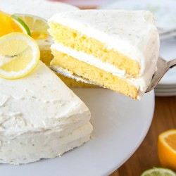A cake with citrus fruits on top