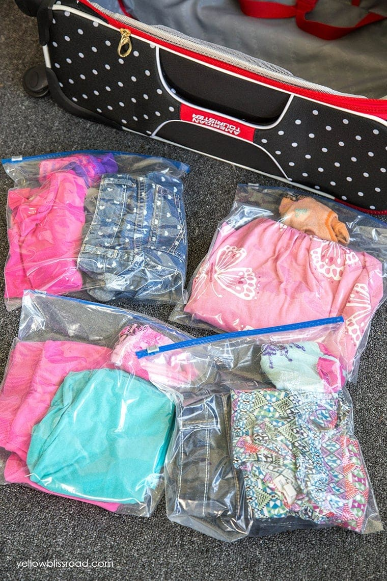 Packing Tip #2 - Pack kids outfits in Ziploc bags. Click thru for more great packing tips!