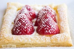 This Puff Pastry Fruit Pizza looks like a fancy dessert that's perfect for company, but it's crazy easy to make!