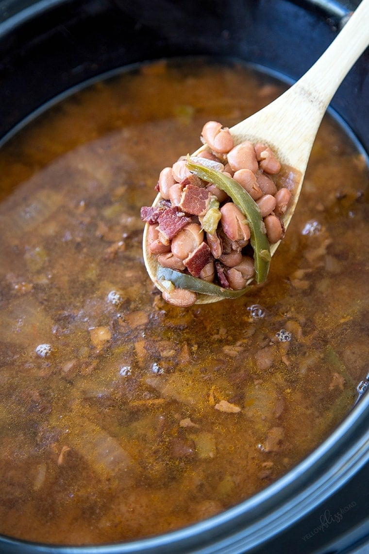 Slow Cooker Beans on a wooden spoon