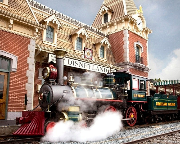 DISNEYLAND RAILROAD AT MAIN STREET STATION -- With its turn-of-the-century architecture and lush gardens, the Main Street station offers the first point of entry for those who wish to soak up the scenery on a grand circuit tour of Disneyland park aboard one of the trains of the Disneyland Railroad which run on bio-diesel fuel created from recycled cooking oil used throughout the Resort. (Scott Brinegar/Disneyland)