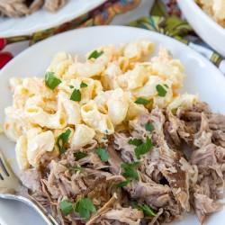 A plate with pork and macaroni salad