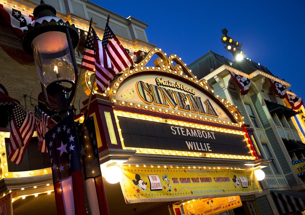 The Main Street Cinema marquee, lit up and adorned with American flags, photographed on Main Street, U.S.A. at Disneyland Park in Anaheim, Calif. (Paul Hiffmeyer/Disneyland)
