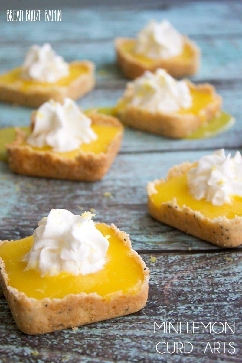Mini Lemon Tarts - Mini Shortbread shells hold a tart and sweet lemon curd. It's the perfect spring dessert!