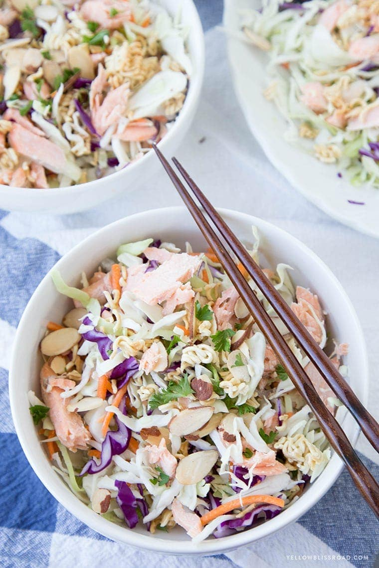 Three bowls of ramen noodle salad with salmon
