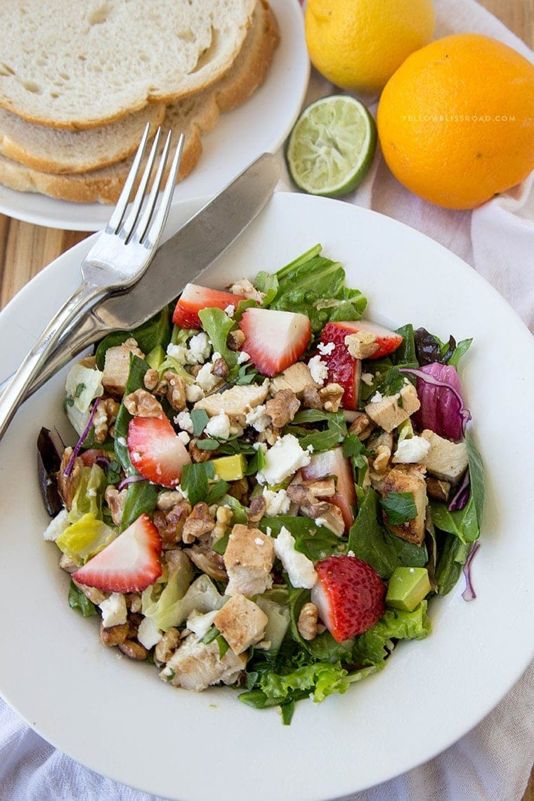 Citrus Chicken Salad with strawberries, Feta and toasted walnuts, coated in a tangy Citrus Herb Vinaigrette