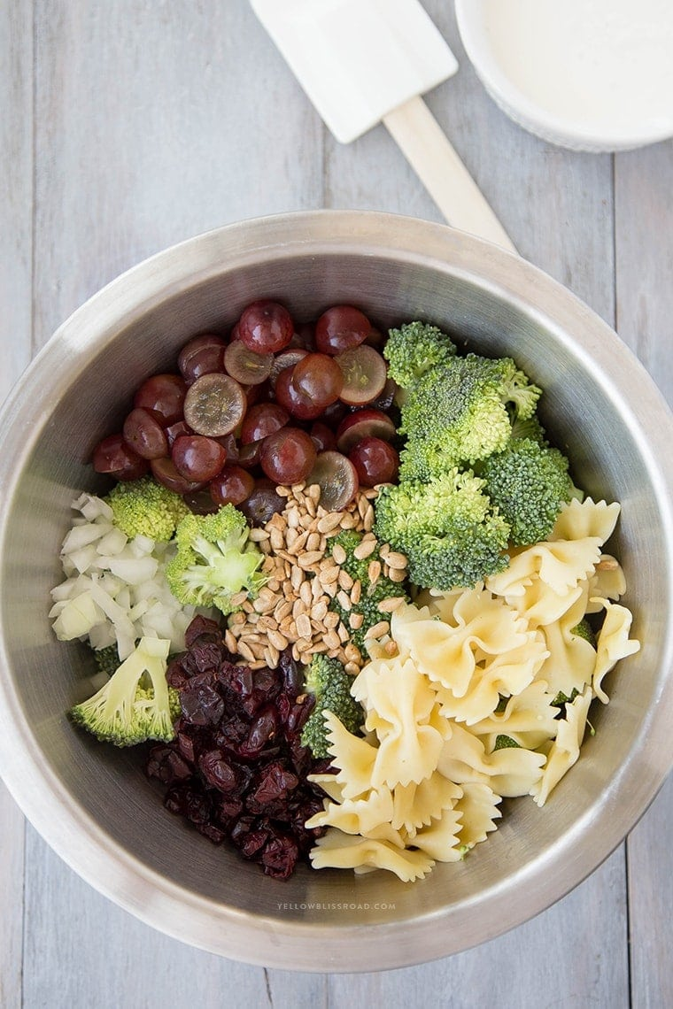 Lightened Up Creamy Broccoli & Grape Pasta Salad is a Classic Broccoli Salad lightened up with Greek Yogurt and sweetened with honey and grapes - this is the perfect side dish any time of the year