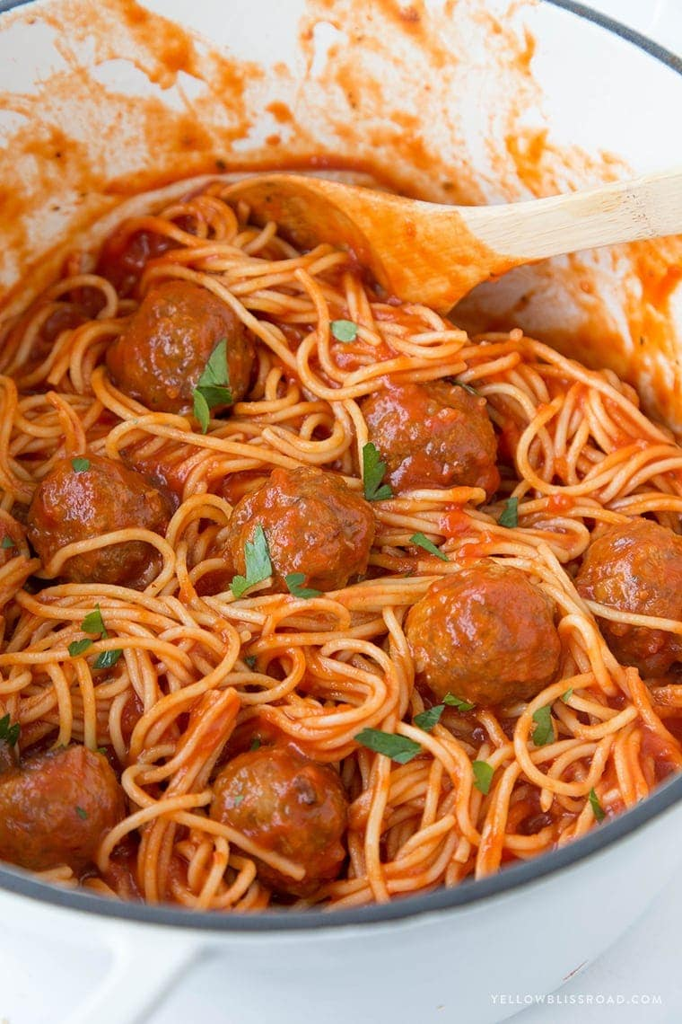A big pot of spaghetti with meatballs and sauce