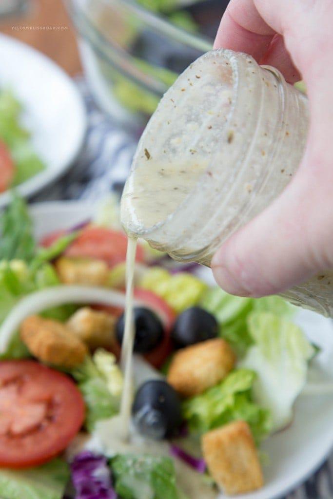 olive garden Salad dressing pouring over a salad