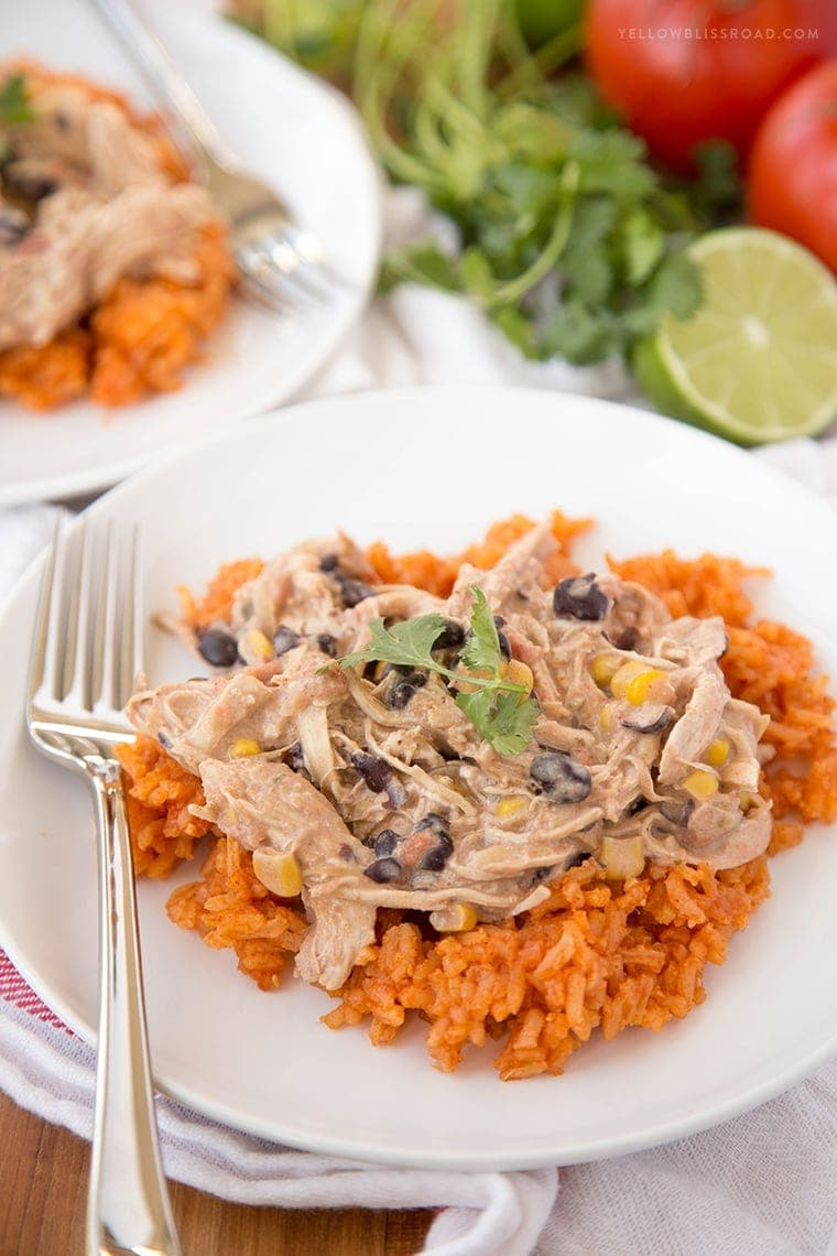 A close up of taco ranch chicken over a bed of mexican rice.