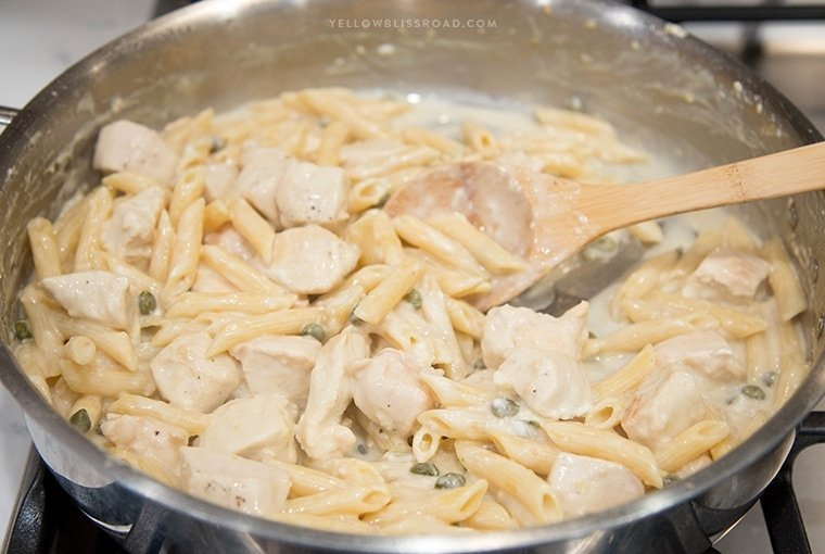 One Pan Creamy Lemon Chicken Picatta Pasta - Tender chicken and pasta are coated with a luscious lemony cream sauce with capers. Easy weeknight dinner that's classy enough for company.