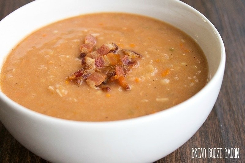 An image of a bowl of bacon and bean soup.