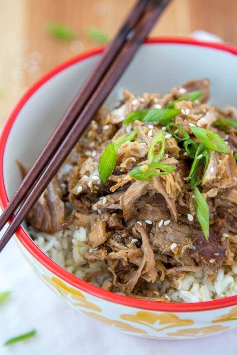 Slow Cooker Brown Sugar & Garlic Teriyaki Pork - Just a few ingredients make this crock pot meal a sure winner for your busy weeknight dinner. Just add rice and veggies for a complete meal!