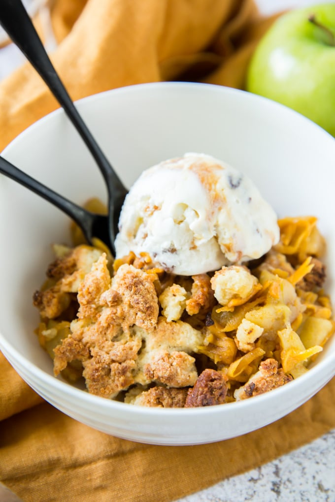 A bowl of apple cobbler with ice cream