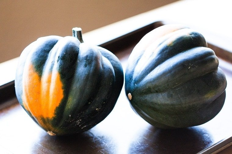This Baked Acorn Squash is beyond delicious with its butter, maple syrup and spices center. The perfect Fall side dish!
