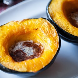 A close up of acorn squash on a plate
