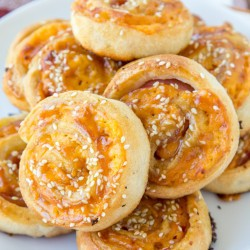 A plate of ham and cheese roll ups