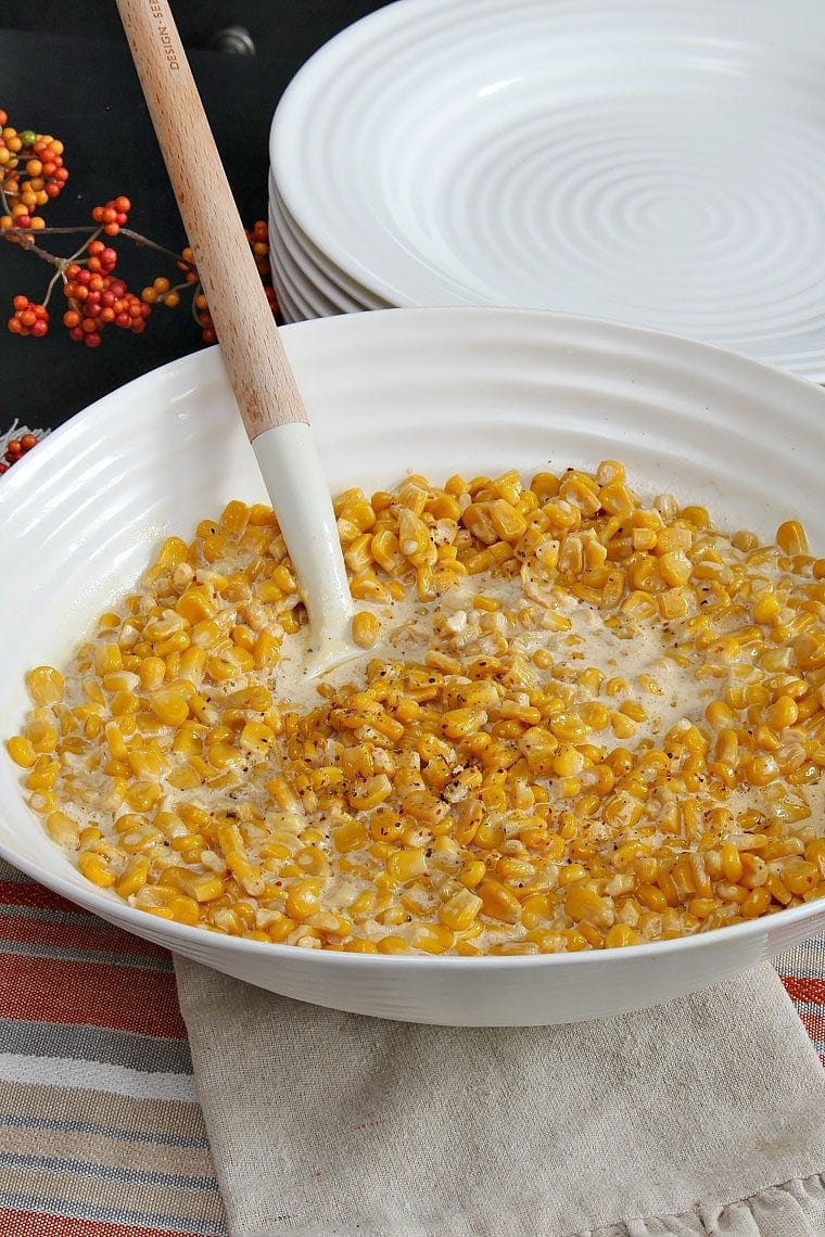 Slow Cooker Creamy Corn - Sweet corn in a creamy sauce, made easily in your slow cooker and perfect for Thanksgiving!