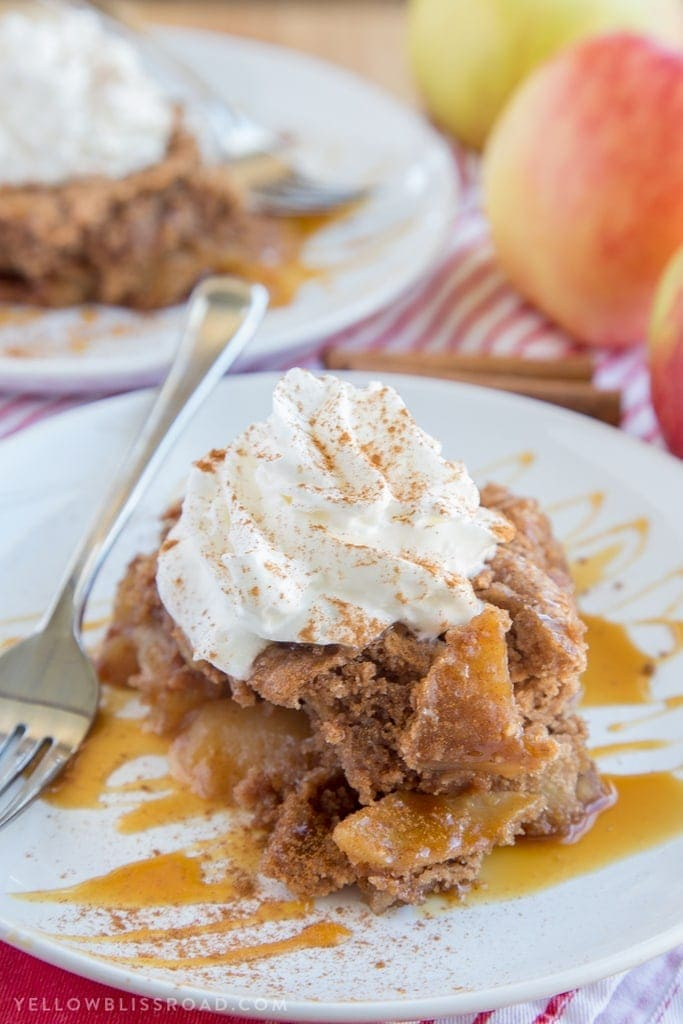 This Slow Cooker Caramel Apple Spice Cake is just the right dessert for your holiday gatherings. It's sweet, with moist spice cake and tender, tart apples.