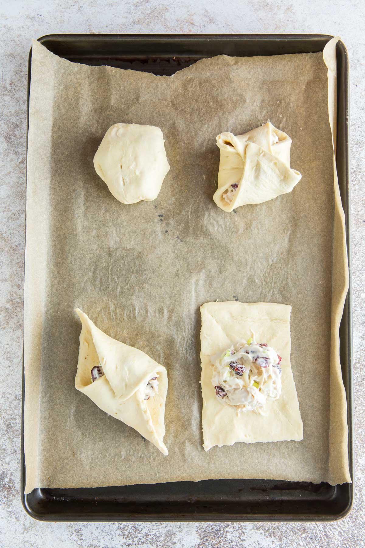 baking sheet, parchment paper, crescent roll dough, chicken salad