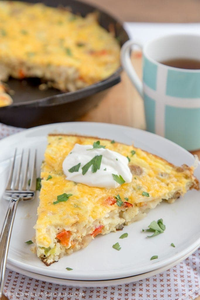 This Sausage & Potato Frittata filled with all the makings of a delicious, hearty breakfast - eggs, veggies, al fresco Country Style Chicken Sausage and Simply Potatoes Shredded Hash Browns - and all in one skillet for a quick and easy breakfast!