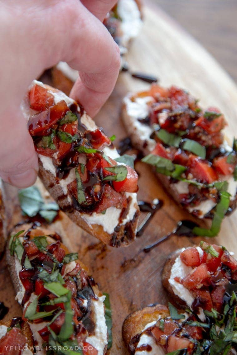 Creamy Three Cheese Bruschetta with Goat Cheese, Cream Cheese and Parmesan. An elegant and classy appetizer that everyone will love!