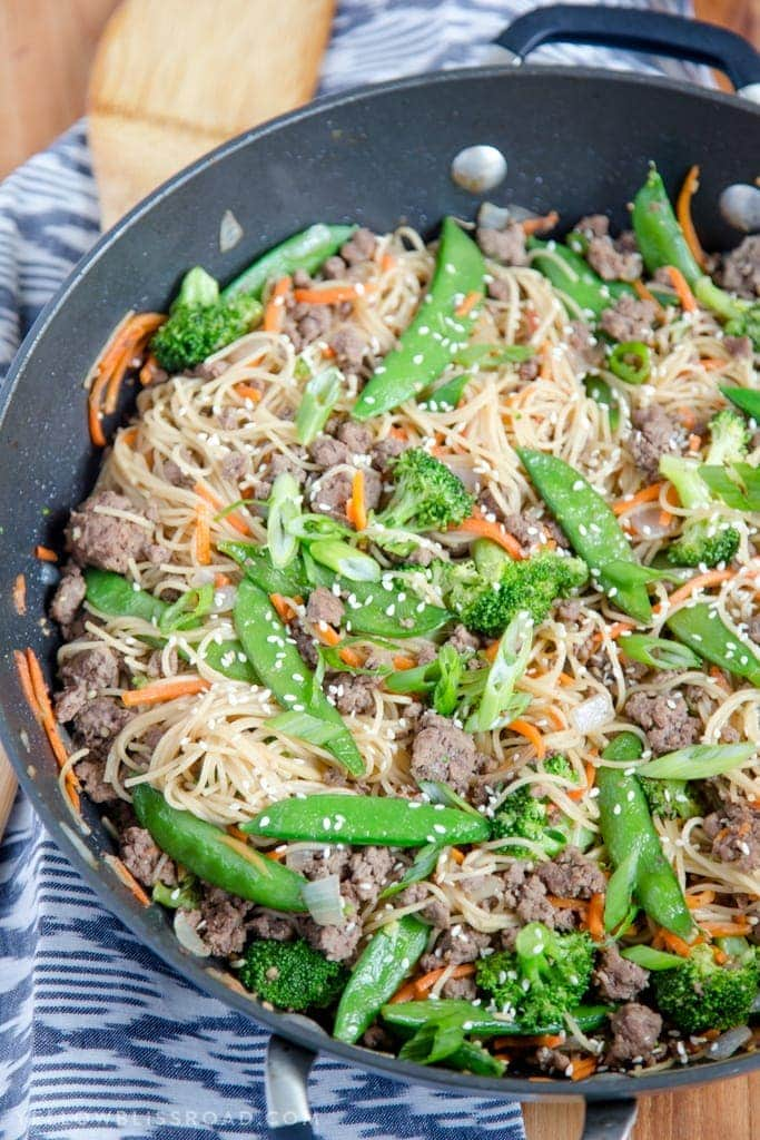 A skillet filled with noodles, ground beef and vegetables