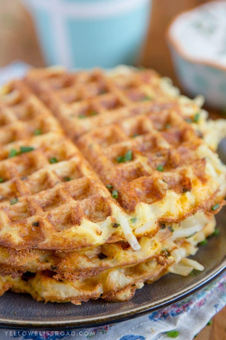 A stack of fresh, crispy Egg & Cheese Hash Brown Waffles,