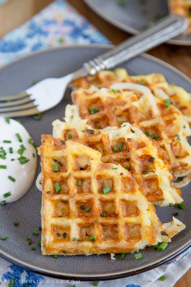 A plate of crispy Egg & Cheese Hash Brown Waffles