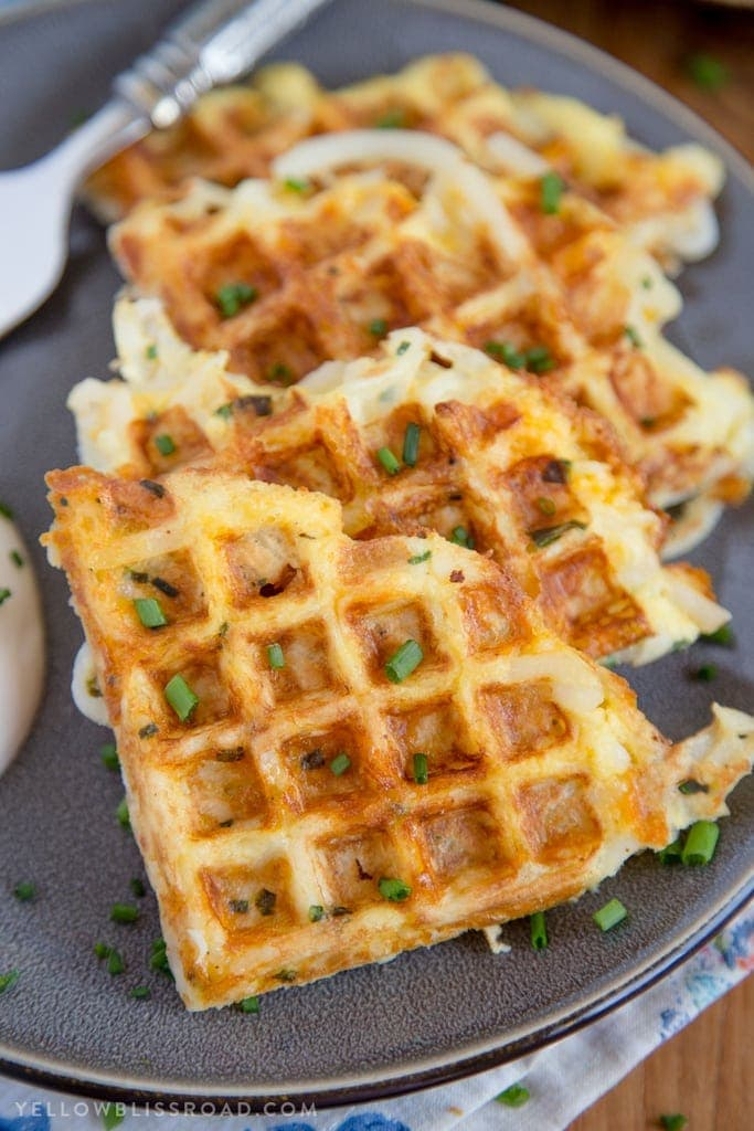 Egg & Cheese Hash Brown Waffle cut into triangles on a plate