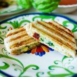 Make this comforting Mediterranean Panini with pesto, artichokes, and sun-dried tomatoes.