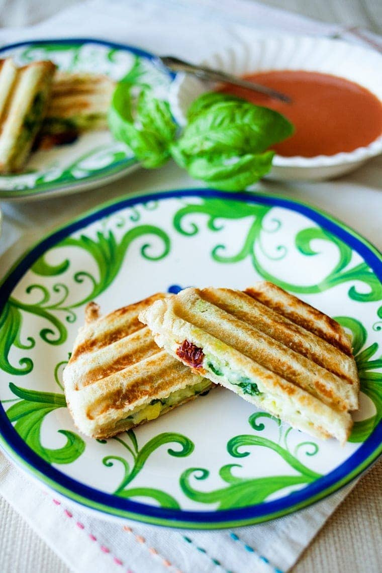 Easily make this Mediterranean Panini with the flavors of sun-dried tomatoes, artichokes, pesto, and more! No panini press needed!