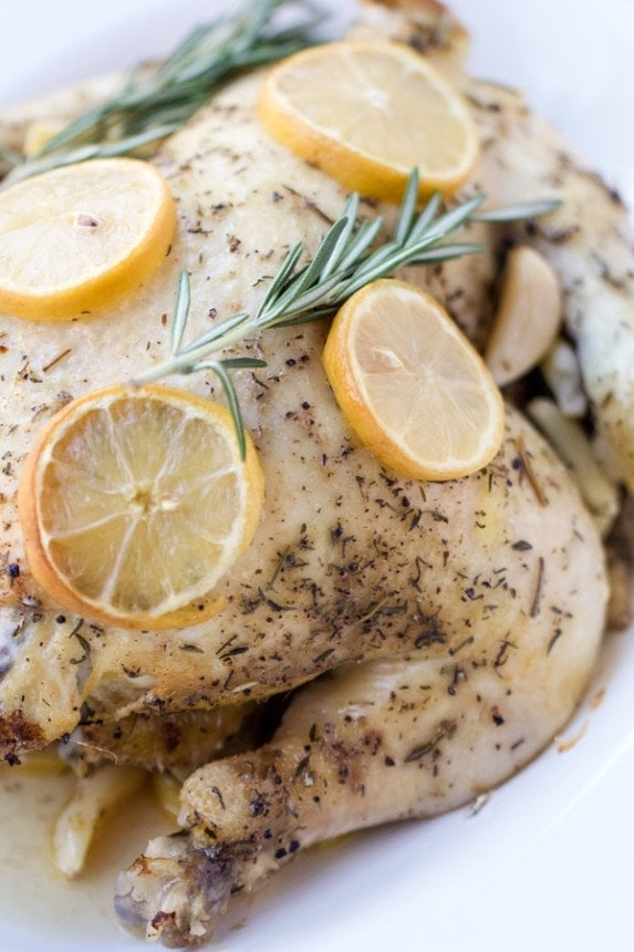 A whole chicken with lemon and rosemary