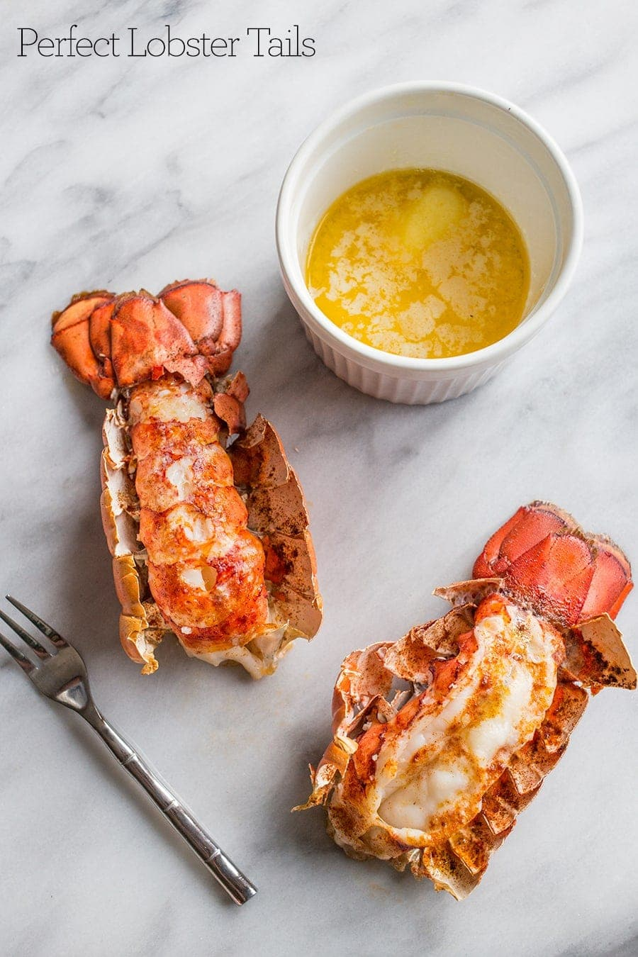 Lobster tails on a table with melted butter