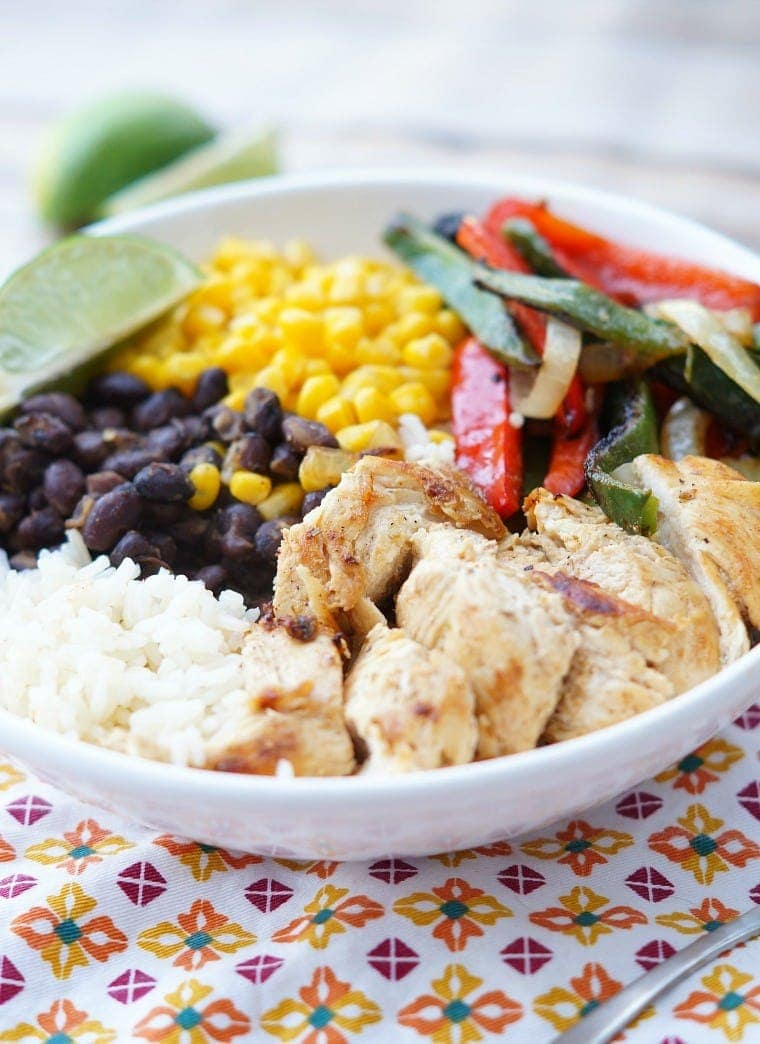 Healthy Chicken Fajita Bowls with chicken, peppers, beans and corn.