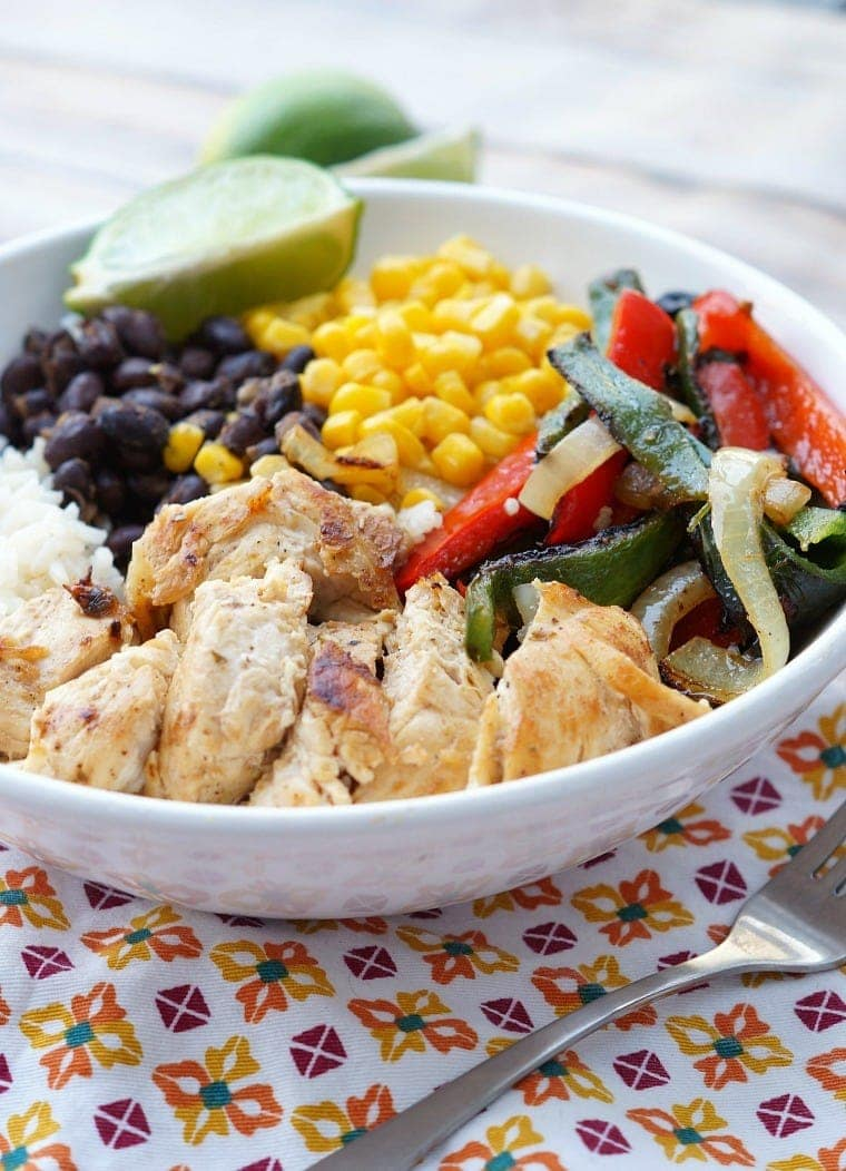 Healthy Chicken Fajita Bowls with chicken, beans and peppers over rice.