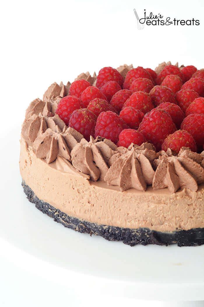 A chocolate cake with raspberries