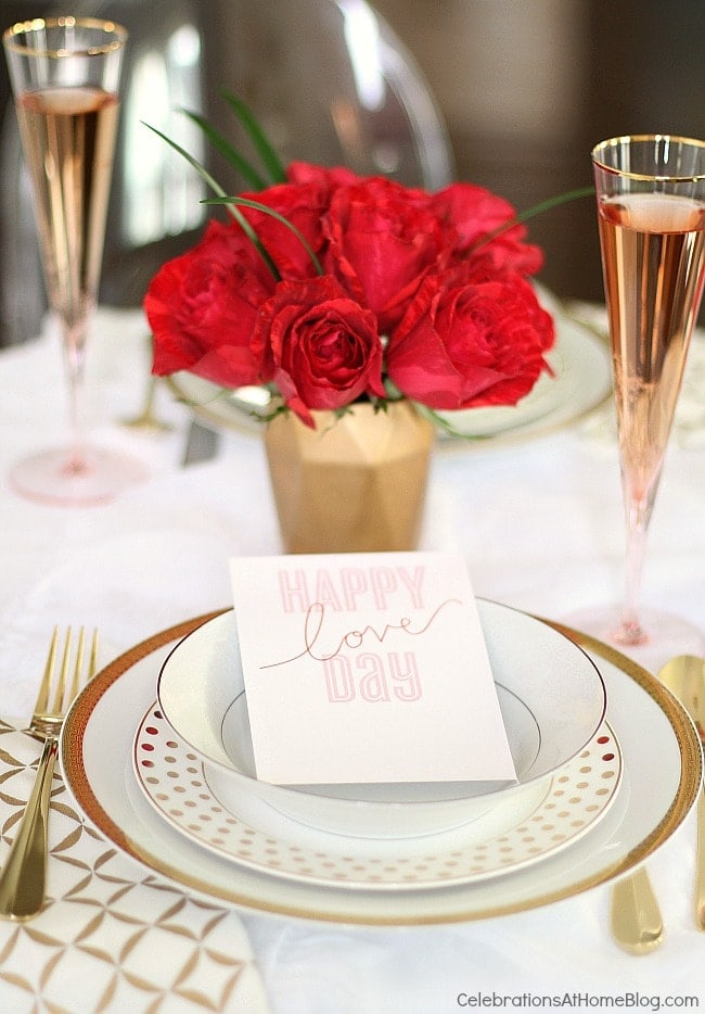 A decorated table with red roses