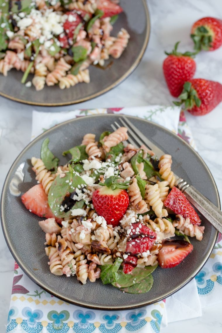 This Balsamic Strawberry Pasta Salad with chicken, pasta, basil, spinach, sweet strawberries, and a tangy Strawberry Balsamic Vinaigrette.