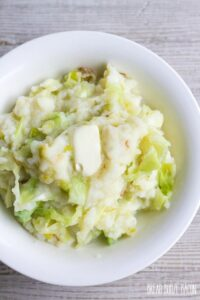 Colcannon is a traditional Irish recipe of mashed potatoes, cabbage & leeks that's perfect for celebrating St. Patrick's Day!